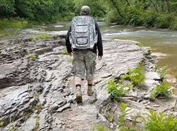 zach-backpack-river